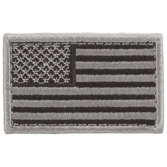 Condor toppa bandiera USA in fogliame